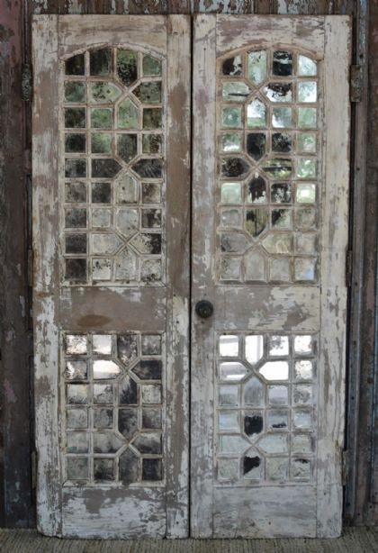 Vintage Door With Antique Mirrorwork And Faded Paint Tones